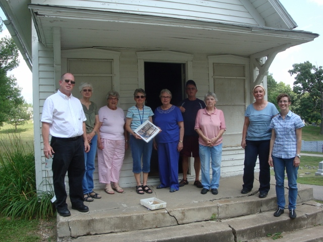 cemetery volunteers at shed