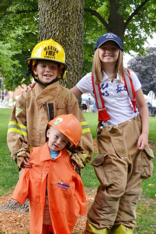 kids dressed as city employees