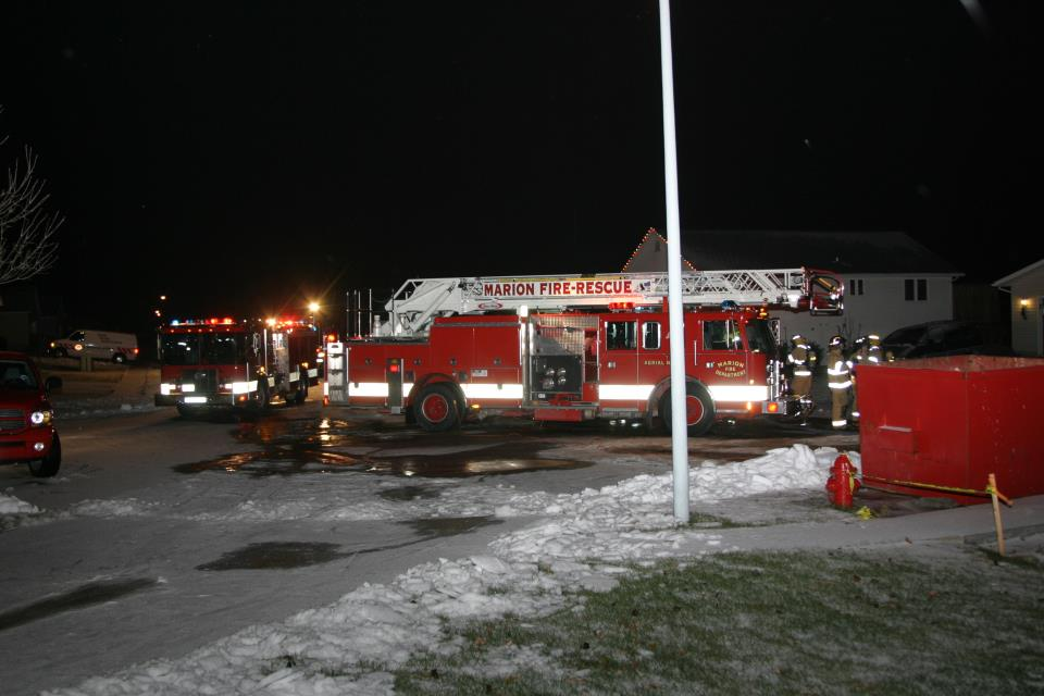 fire truck on a call in winter