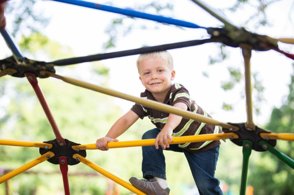 boy on jungle gym