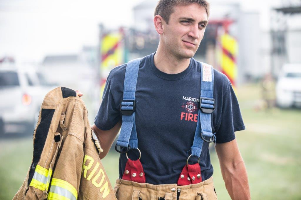firefighter carrying coat